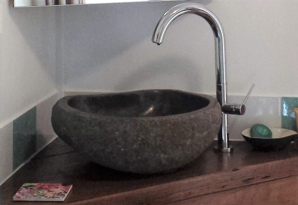Stone basins are hand cut and carved from solid Balinese river rock.