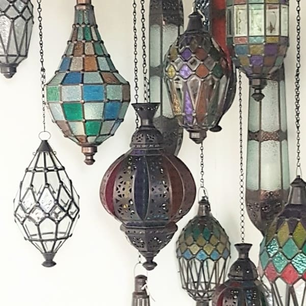 CasaPandan Bali lanterns hardwired or candle lit. Glass and brass handcrafted in Bali will not rust. They have a large door on the side for easy access.